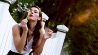 Beautiful woman blows bubbles video