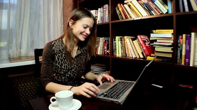 Beautiful woman chatting online, business communication video