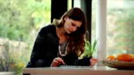 Beautiful woman digital tablet in a modern home. video