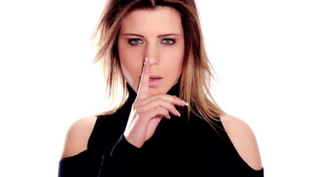 beautiful woman doing a silence sign video
