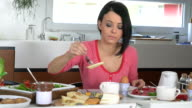 beautiful woman eating breakfast video
