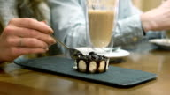 Beautiful woman eating cake in cafe video