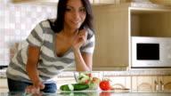 Beautiful woman eating salad video