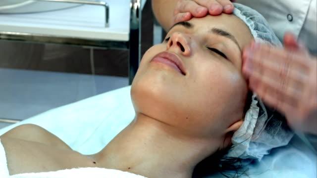 Beautiful woman having a facial massage video