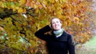 Beautiful woman in Autumn video