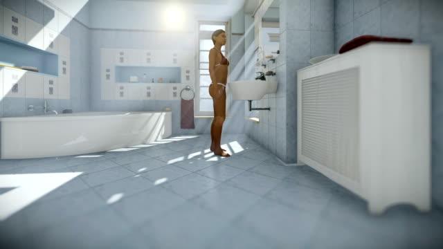 Beautiful woman in modern bathroom interior, tilt video