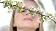 Beautiful woman in orchard. video