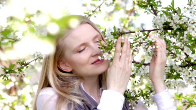 Beautiful woman in orchard. video