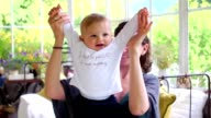 Beautiful woman lifts high her adorable baby video