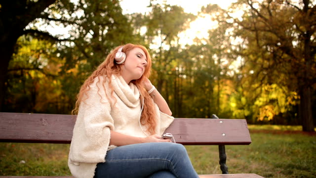 beautiful woman listening to music on headphones video
