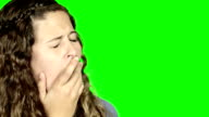 Beautiful woman looks to side, yawning, then turns to camera and gives a huge, shuddering yawn. video