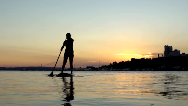 Beautiful woman on Stand Up Paddle Board. SUP. video