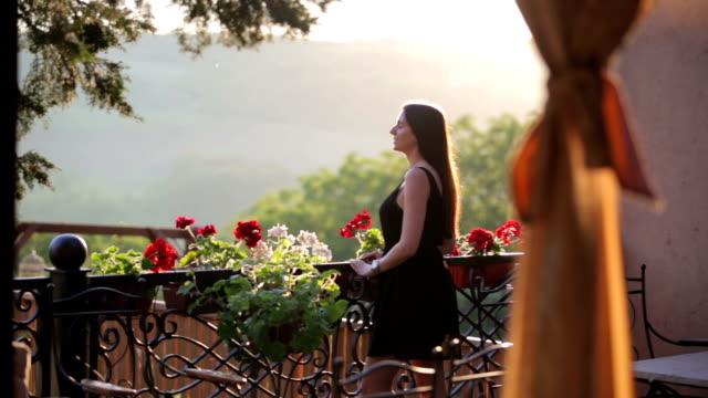 Beautiful woman on the balcony video