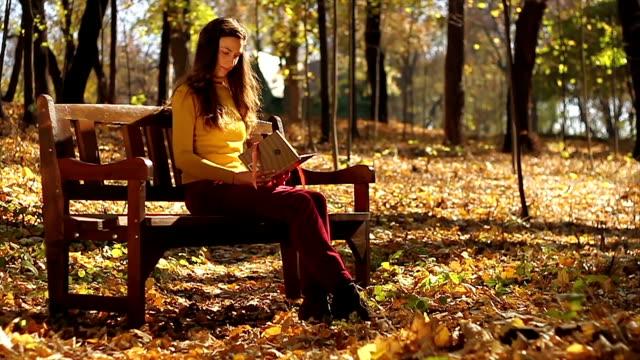 Beautiful Woman Reading Smiling Autumn Nature video