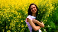 Beautiful Woman Relaxing Holding Yellow Flowers Summer Field HD video