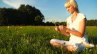HD DOLLY: Beautiful Woman Relaxing In Meadow video