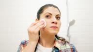 Beautiful woman removing make up video