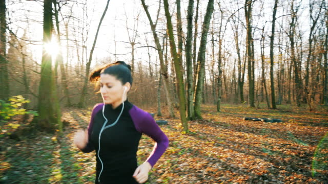 Beautiful woman running in the forest. video