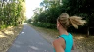 Beautiful woman running in the park in slow motion video