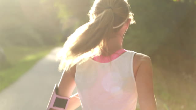 Beautiful woman running in the park video