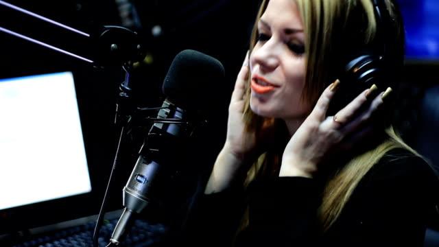 Beautiful Woman Singing In Studio video