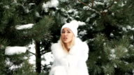 Beautiful woman sings and dances against background of winter landscape video