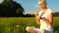HD DOLLY: Beautiful Woman Smelling Daisies video