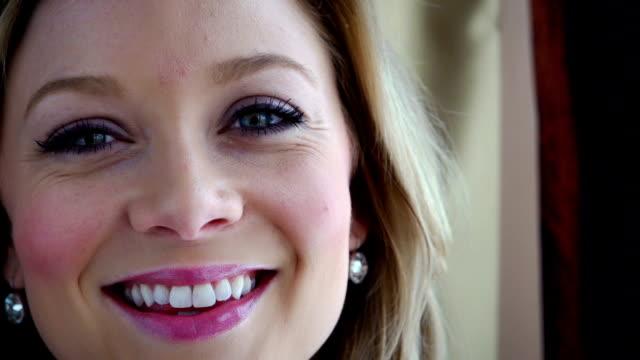 Beautiful woman smiling at camera video