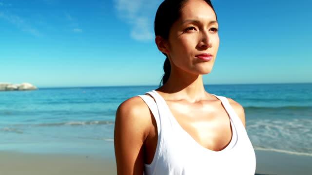 Beautiful woman standing on beach video