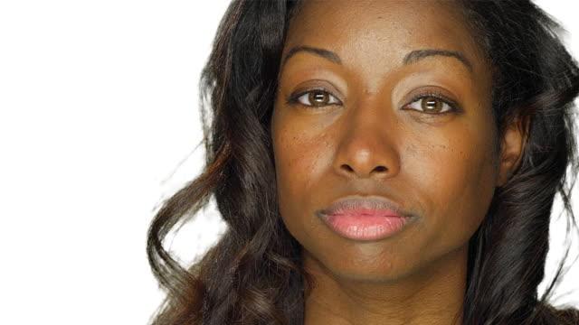 Beautiful woman staring, on a white studio background video