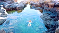 Beautiful Woman Swimming in Tide Pool at Sunset. video