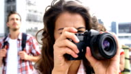 Beautiful woman taking pictures video
