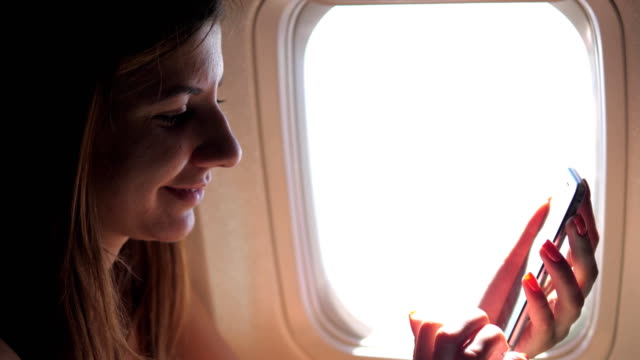 A Beautiful Woman Uses The Phone, Sitting At The Window Of The Plane video