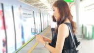 Beautiful woman waiting The train video