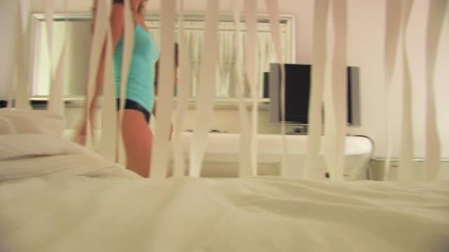 Beautiful woman walk across hotel room video