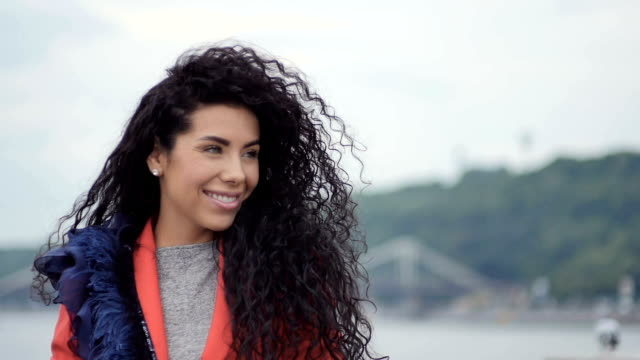 Beautiful woman with curly hair video
