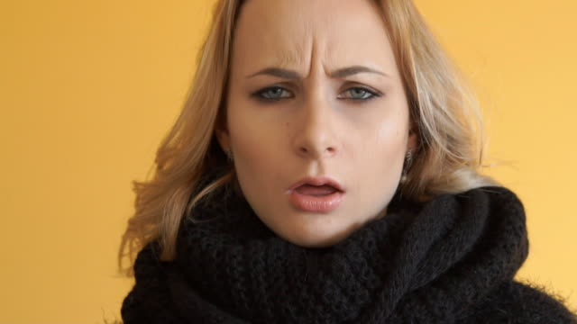 Beautiful woman with flu sneezing sad video