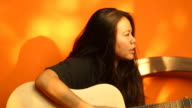 Beautiful woman with guitar video