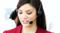 Beautiful woman working in a call center video