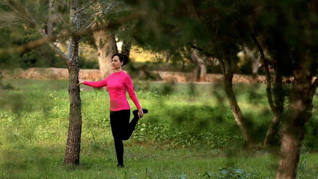 beautiful women doing streching exercising in the nature video