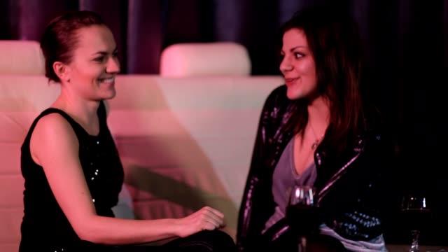 Beautiful women drinking and chatting video
