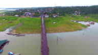 Beautiful Wooden Pedestrian Bridge cross River in the Morning video