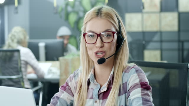 Beautiful young call-centre assistant video