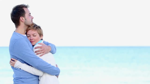 beautiful young couple embracing on the beach video