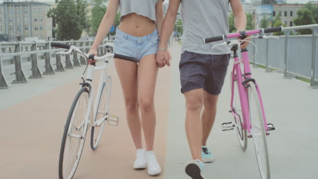 Beautiful young couple on bicycles video