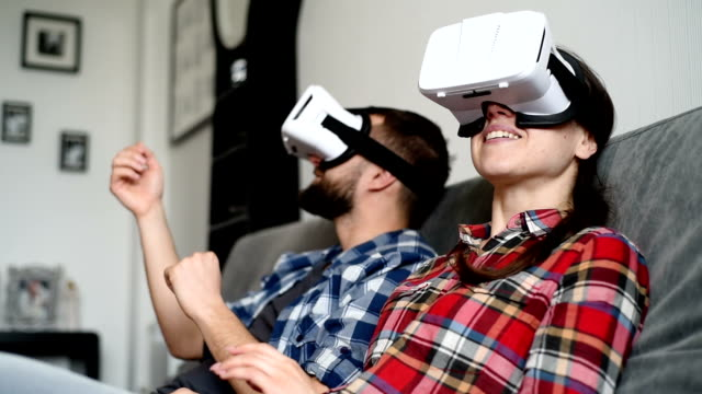beautiful young couple with glasses of virtual reality video