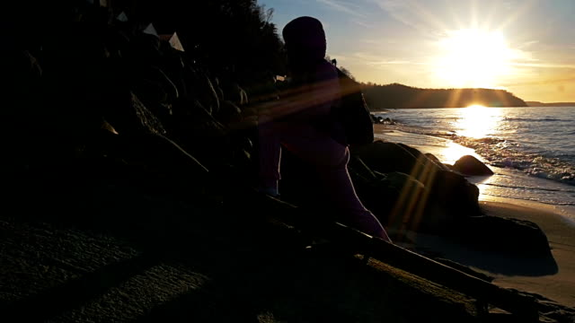 Beautiful young gir, background of sun rays engaged in fitness. Pink clothes, spring time, Slow motion. Medium shot video