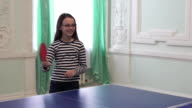 Beautiful young girl plays table tennis stock footage video video