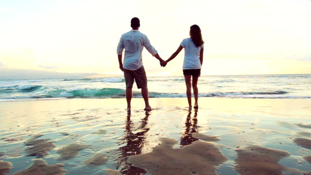 Beautiful Young Holding Hands Standing at Waters Edge. Honeymoon Romance. video
