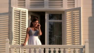 Beautiful Young Lady on Phone at Balcony video
